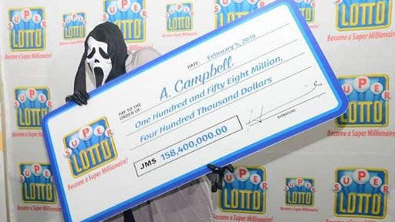 Man masks his face to recieve his lottery prize
