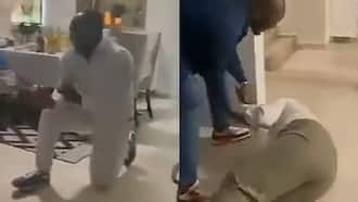Lady breaks down on the floor in emotional video as boyfriend proposes to her