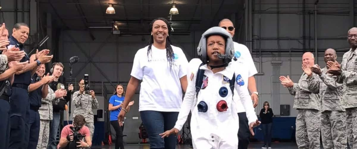 Mission accomplished: Zayden proudly walks back to earth with his parents behind him. Photo: Make-A-Wish Georgia
