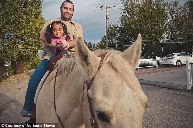 Maria with her adoptive father, Jason. Photo: The Stewart Family