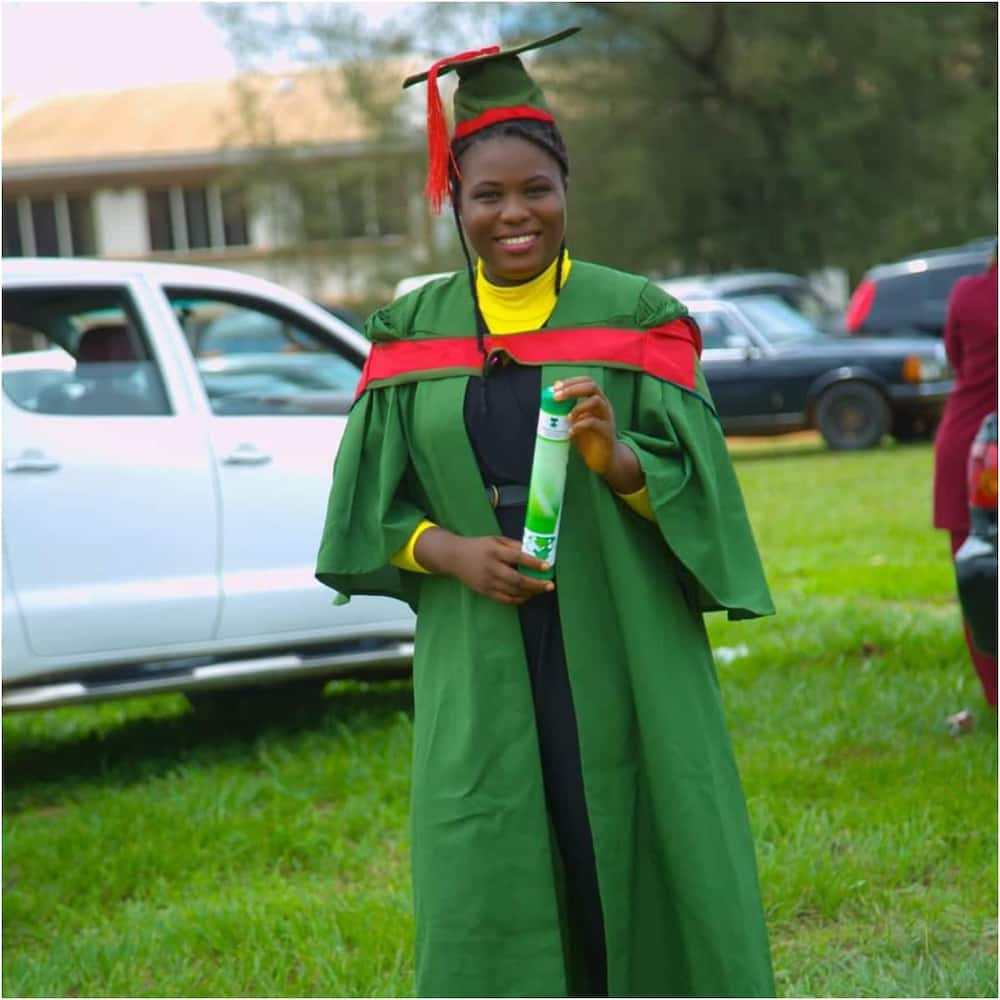 Sarah smiles in her UNN graduation gown.