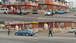 Get her into Police MTTD - Ghanaians react as female pure water seller directs traffic like a pro in Kumasi