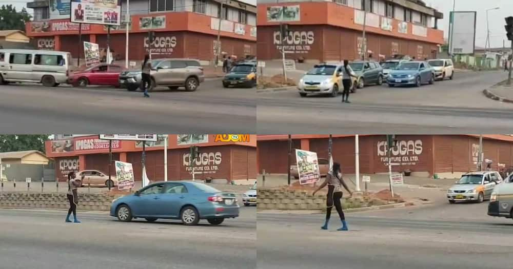 Female Pure Water Seller Directs Traffic Like A Pro After Power Outage in Kumasi; Ghanaians Praise Her (Video)