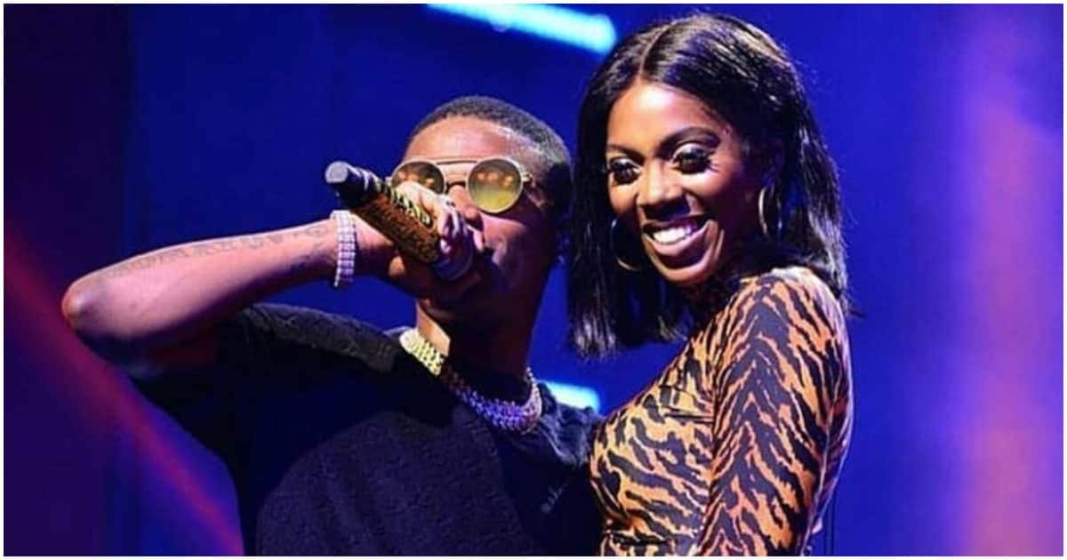 Wizkid captured on camera playfully hitting Tiwa Savage's backside at a resort (video)