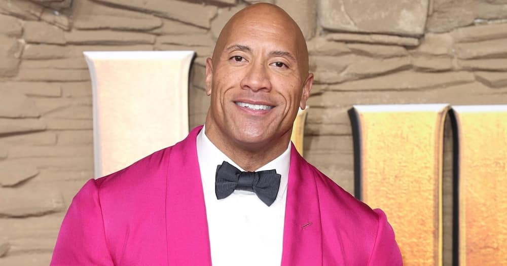 The Rock surprised a teacher who graduated from university after being a school cleaner for more than 20 years. Photo: Getty Images.