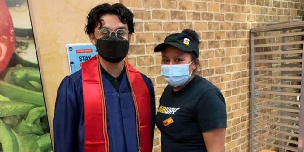 The young graduate posed for a photo with the kindhearted woman who fed him in school