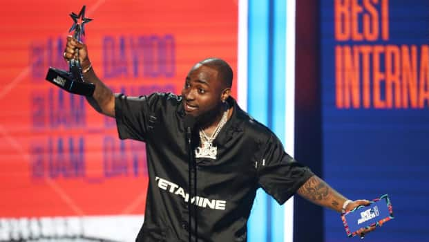 Video: Davido holds a lady's hand to stroke his 'rod' while performing