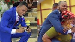 Obinim makes elderly woman carry him during deliverance from waist pain; 2 photos drop