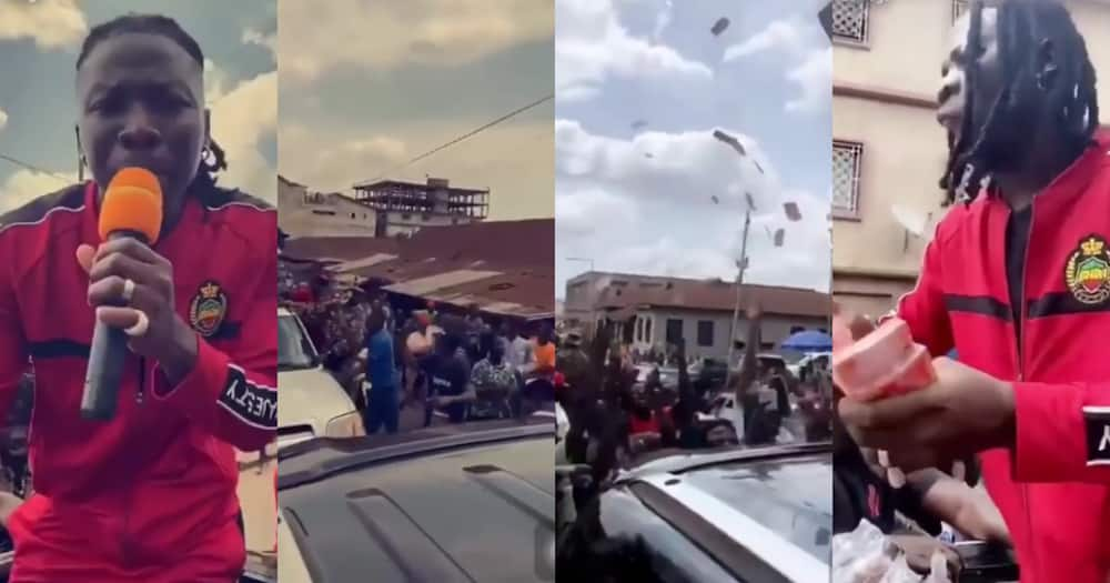 Stonebwoy mobbed as he sprays money on fans in Kumasi streets (video)
