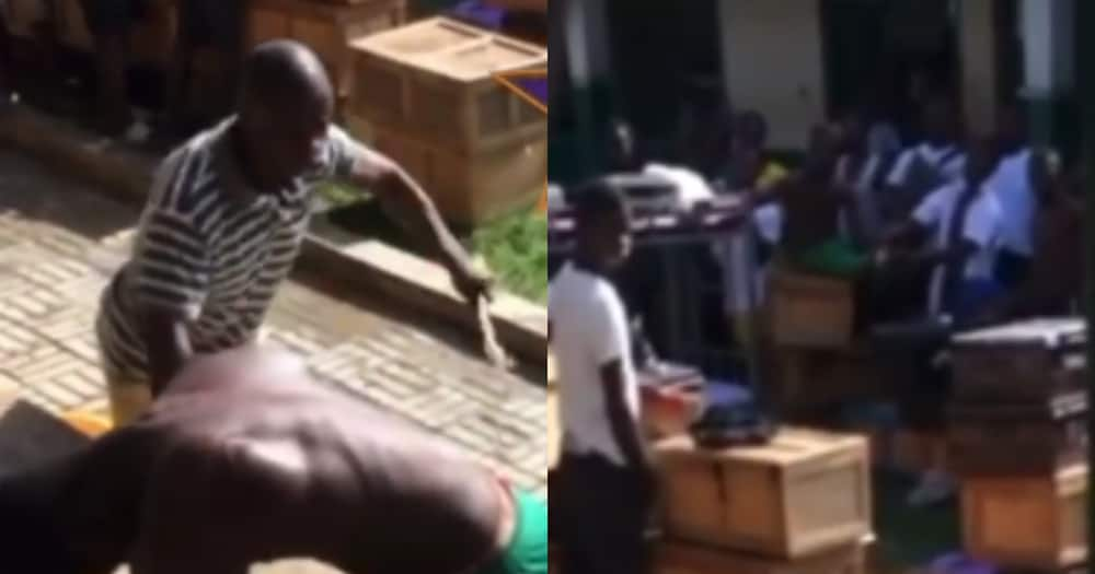 Hard guy: SHS student boldly poses for canes as housemaster whips him 25 times in video