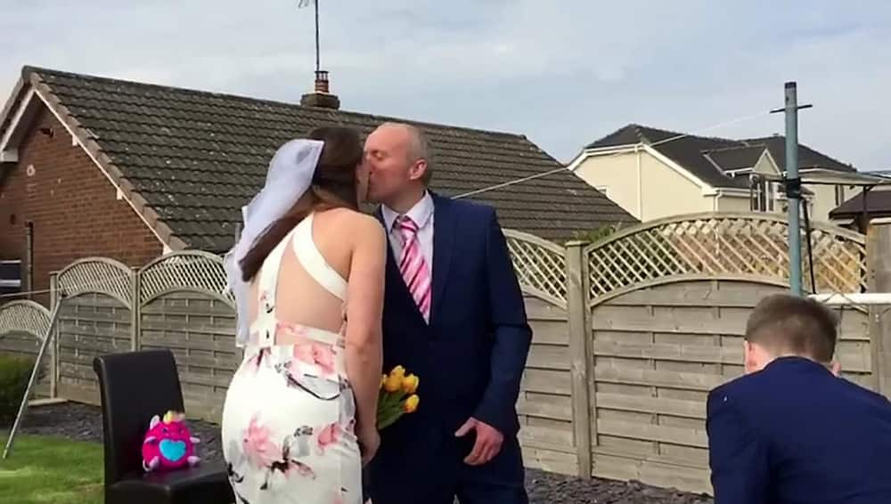 Children surprise their parents with a garden wedding after their big day was cancelled due to COVID-19