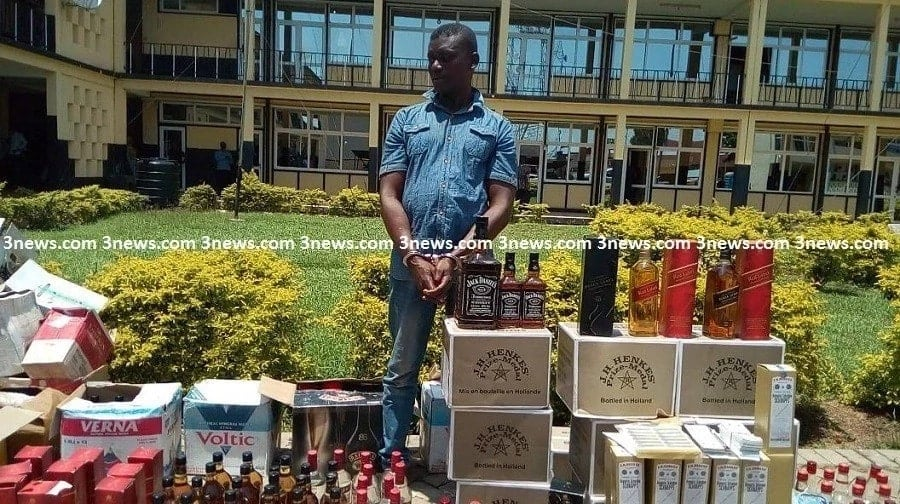 A man surrounded by alcoholic beverages