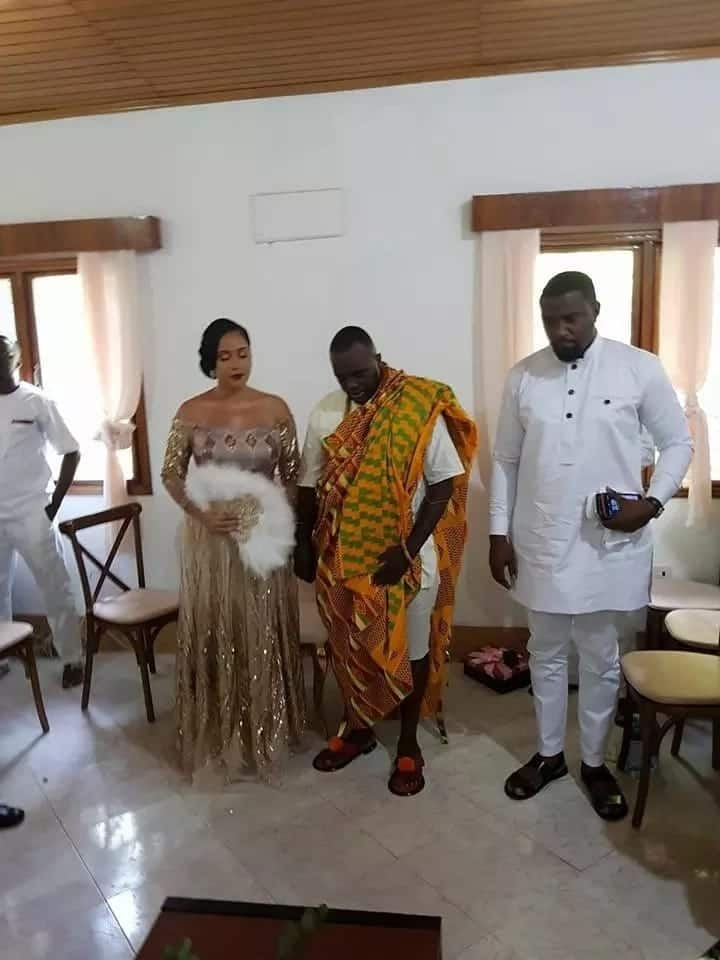 John Dumelo standing with the couple