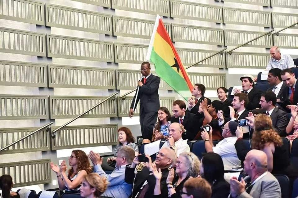 First Ghanaian Man to participate in Space Studies program holds Ghanaian flag high