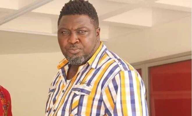 A man wearing a multicloured shirt
