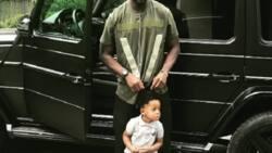 Little Jamal Muntari 'chills' with uncle Sulley Muniru in classy G-Wagon
