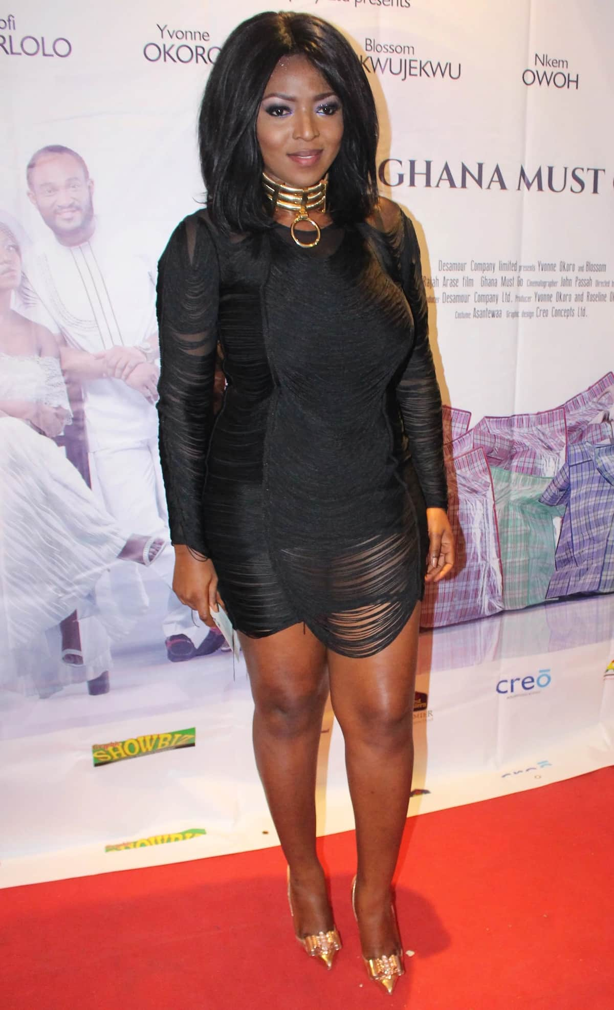 Yvonne Okoro stands on the red carpet wearing a black dress