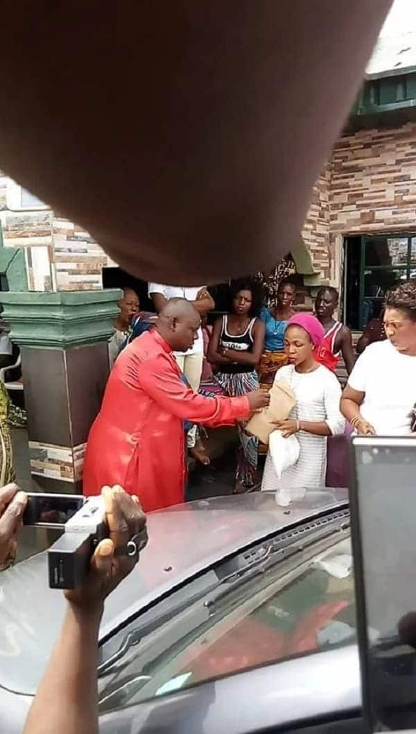 The pastor returning the car keys sand documents to the lady