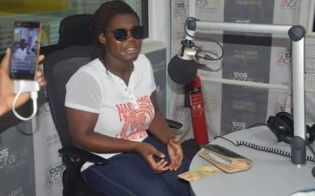 Evelyn Boakye seated in a radio station
