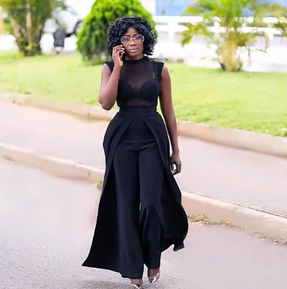 Nana Akua Addo wearing a black dress