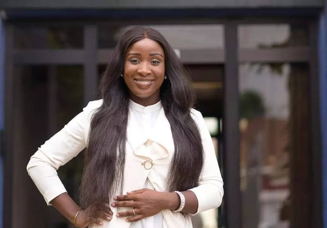 Naa Ashorkor poses for a photo in a white shirt
