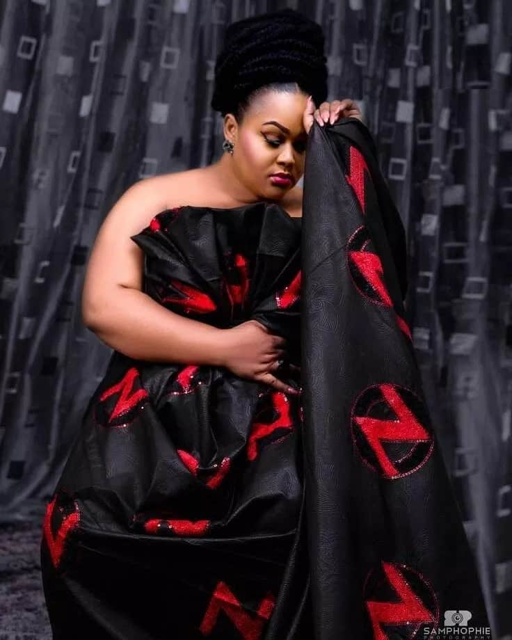 Actress in stylish traditional funeral outfit
