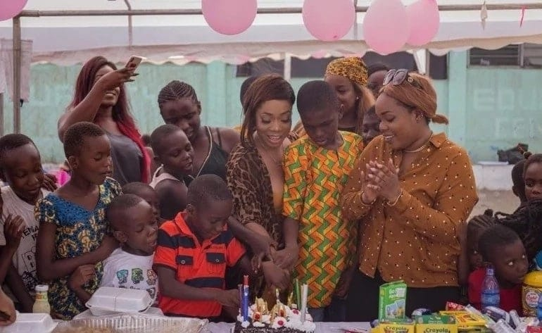 Moesha Boduong helping to cut a cake