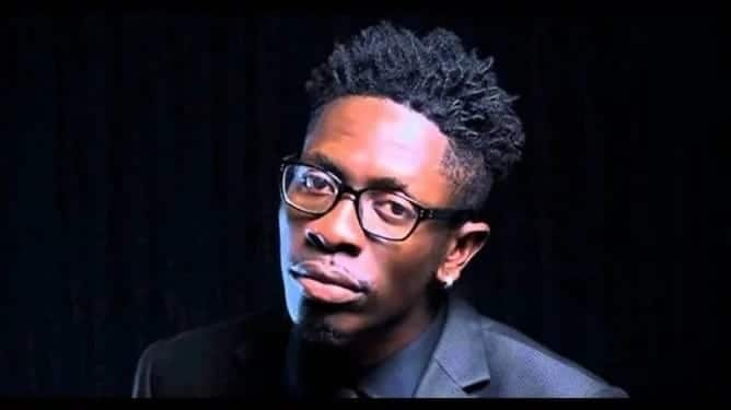Shatta Wale wearing a suit and spectacles