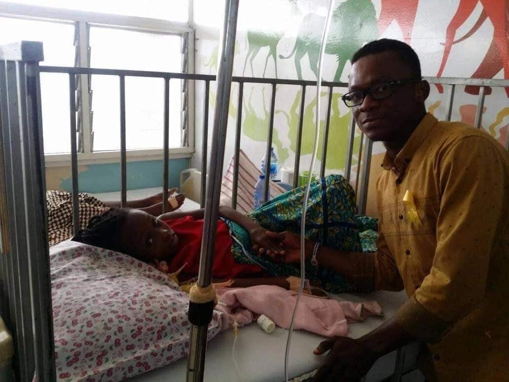 Prince Senyo with an affected child at the hospital