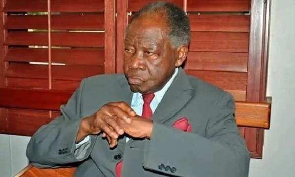 Deceased Ghanaian Diplomat, KB Asante, dressed in a grey suit