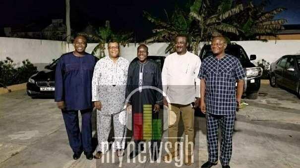 Five men posing for a photo