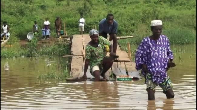 Pupils at Tapa Abotoase in the Volta Region swim to cross river to school