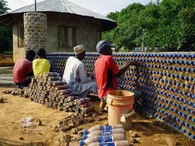 Meet the Africans constructing houses with plastic bottles