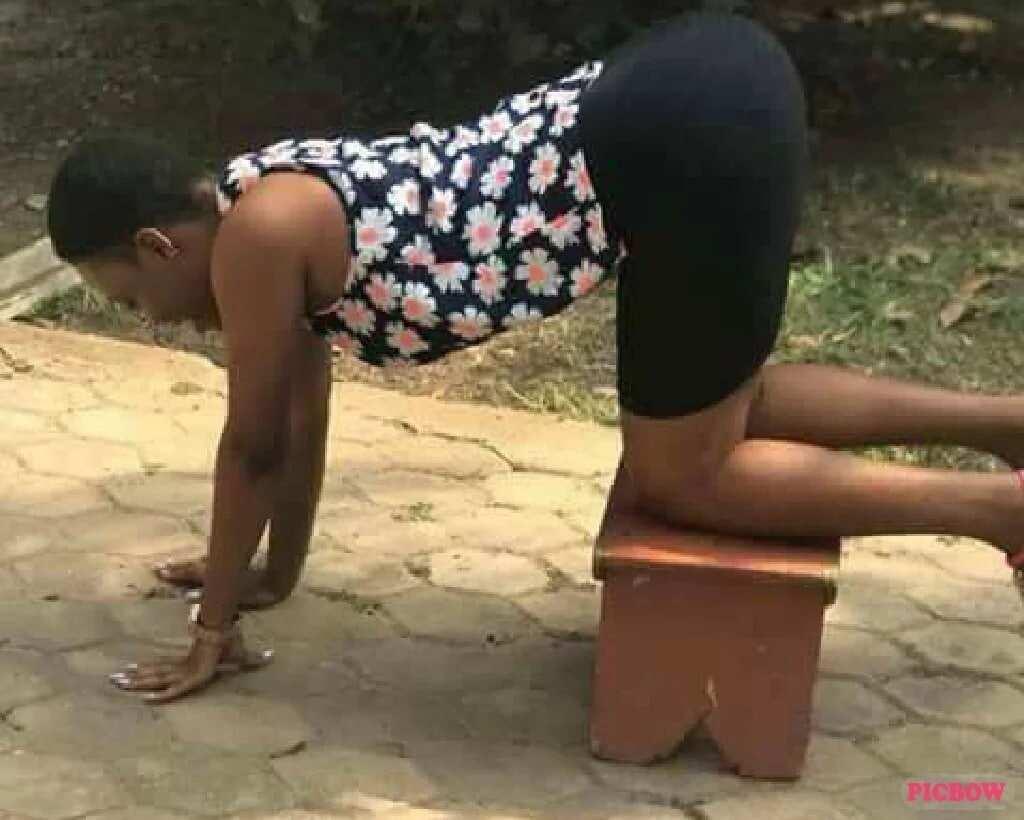 Woman kneeling on a stool
