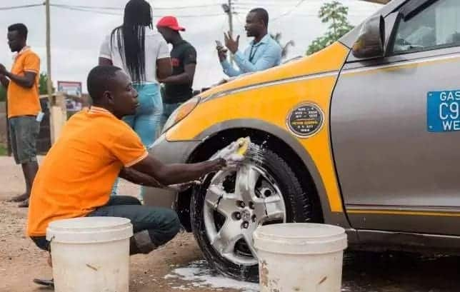 Female entrepreneur employs disabled young men to help her in her washing bay business