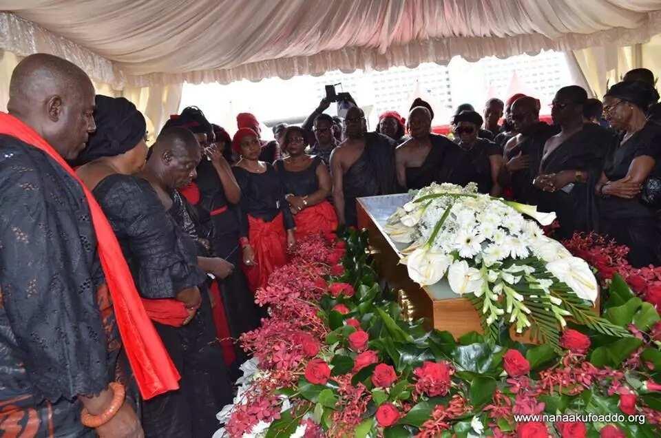 funeral attendees in black
