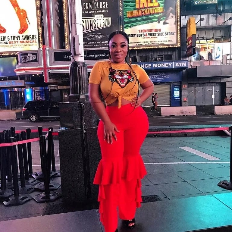 Moesha Boduong poses with wax figures as she enjoys herself in the U.S.A