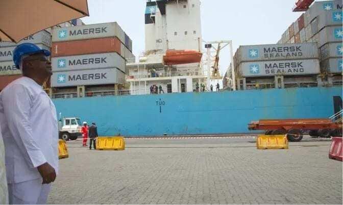 A man standing at a port