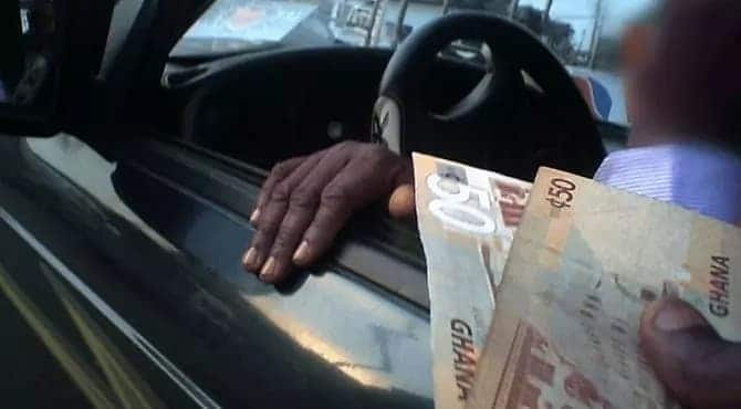 A photo of money changing hands