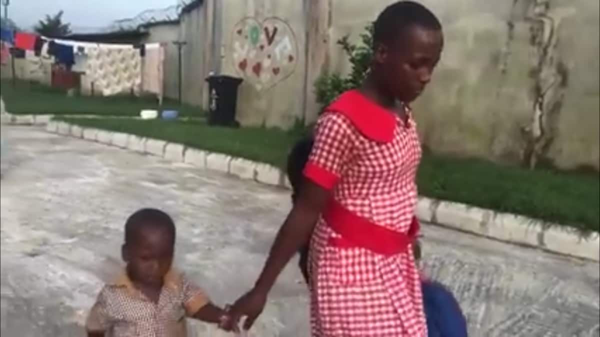Video of a Nigerian girl who gave birth at 13 going to school with her little son pops up