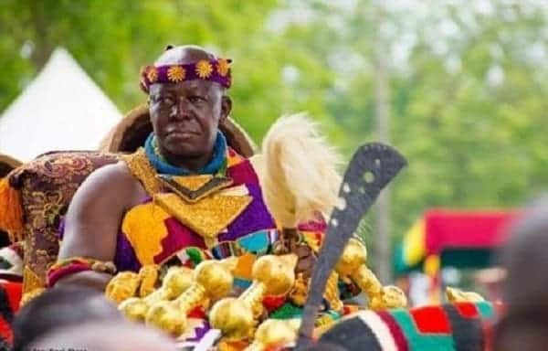 A paramount chief sitting in a palanquin