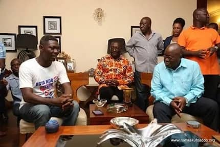 We're not sure what Agya Koo is doing with Nana Addo in these photos