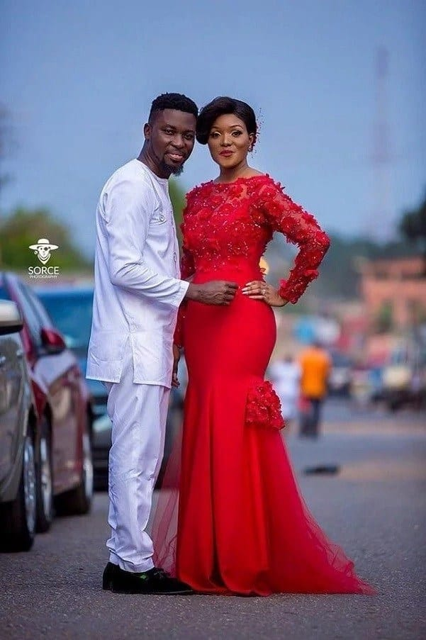 A Plus wearing white and Akosua Vee reading a red dress