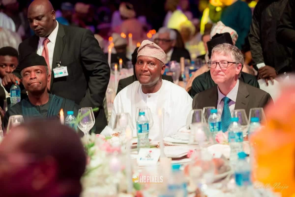 Dangote sitting with Bill Gates and Yemi Osinbajo at the wedding