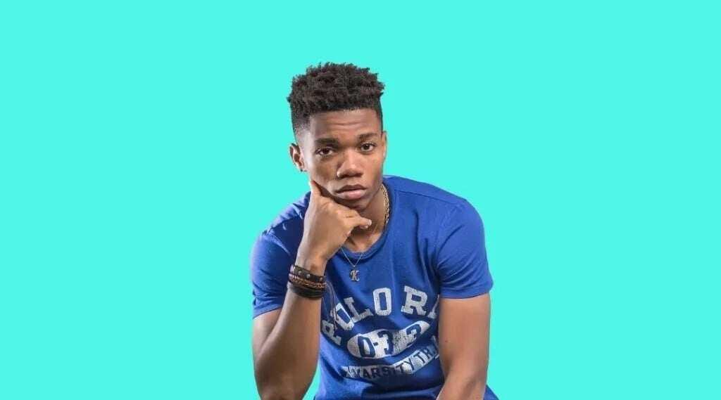 Ghanaian musician Kidi in blue shirt