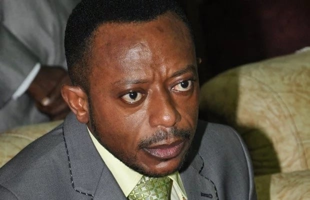 Rev. Owusu Bempah wearing a suit