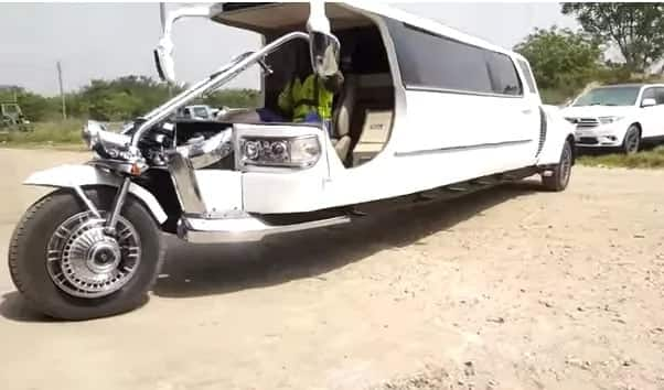 Apostle Kwadwo Safo outdoors impressive luxury motorbike
