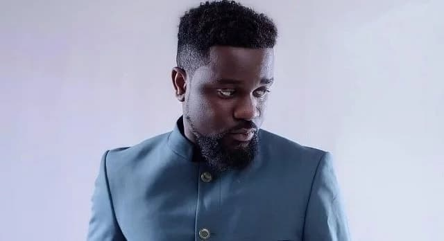 Sarkodie in a blue suit