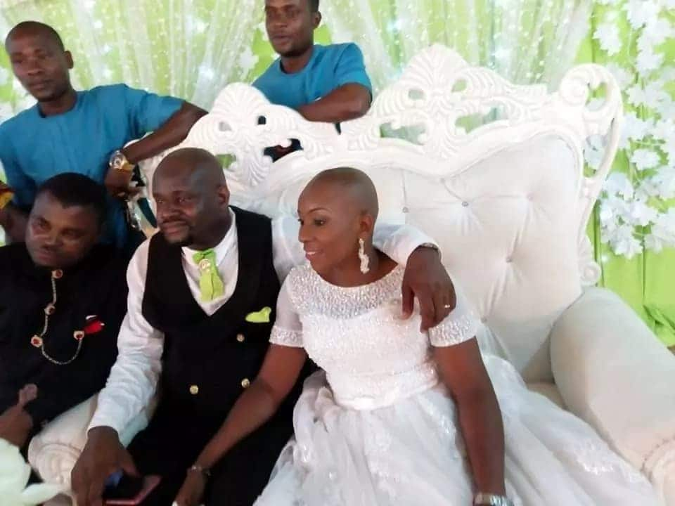 Nigerian couple pose for the cameras on the day of their white wedding