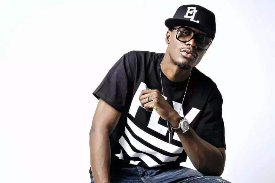 Ghanaian rapper in black t-shirt and sunglasses